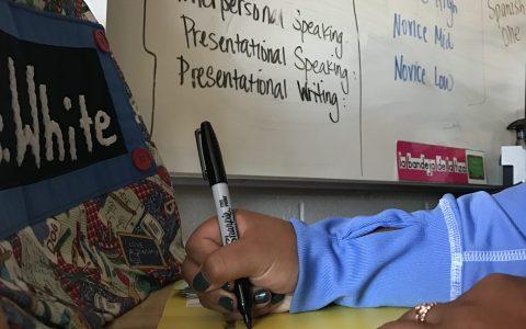 Student updates her proficiency folder